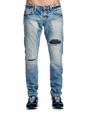 Distressed Washed Jeans by Cult Of Individuality