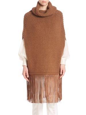 agnona female  turtleneck knit poncho with fringed hem