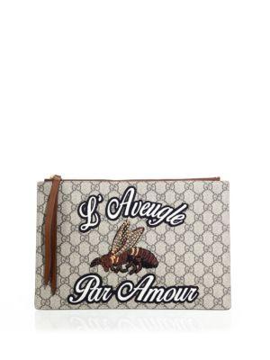 gucci female merveilles leather canvas pouch