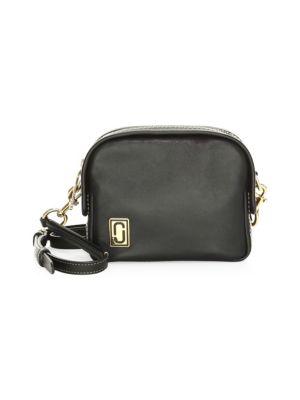 The Mini Squeeze Leather Half-Moon Crossbody Bag