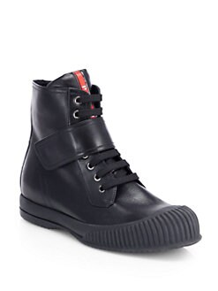 Prada - Leather Lace-Up High-Top Sneakers