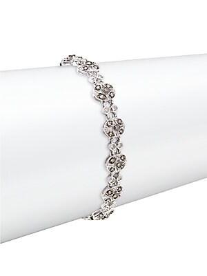 Click here for Diamond & 14K White Gold Bracelet prices