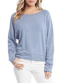 Chambray blue sweater with white jeans.