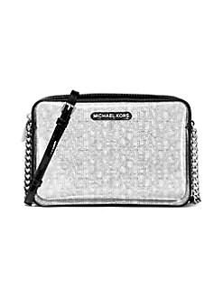 721389b34db9da QUICK VIEW. MICHAEL Michael Kors. Large Clear Logo-Print Crossbody Bag