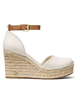 26010a406b4 QUICK VIEW. MICHAEL Michael Kors. Logo Leather Wedge Sandals