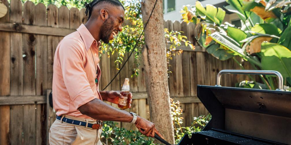 Father's Day Gift Ideas: Cookware and grilling tools like All-Clad barbecue tool set and Emile Henry pizza stone