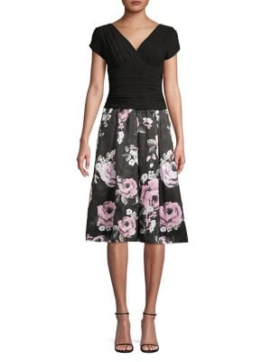f2b3fd562b5f Product image. QUICK VIEW. Ignite Evening. Short Sleeve Ruched V-Neck Floral  Print Dress