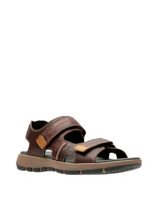 d76693f4489 QUICK VIEW. Collection By Clarks. Brixby Shore Leather Footbed Sandals.   130.00 Now  89.99 · Brixby Cove Leather Footbed Sandals DARK BROWN