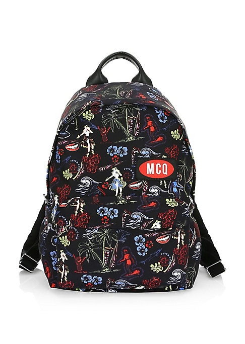 """Image of Vibrant florals lend bold visuals to this embroidered logo patch backpack. Top handle. Adjustable backpack straps. Zip around closure. One exterior front zip pocket. One interior zip pocket. Fully lined. Nylon. Made in Italy. SIZE.9""""W x 15""""H x 6""""D."""