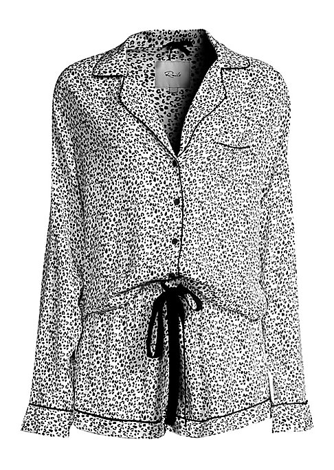 """Image of Allover animal print and contrast piping adorns two-piece set. Rayon. Hand wash. Imported. TOP. Notch collar. Long sleeves. Button front. Chest patch pocket. Contrast piping trim. About 23"""" from shoulder to hem. SHORTS. Elasticized drawstring waist. Pull-"""