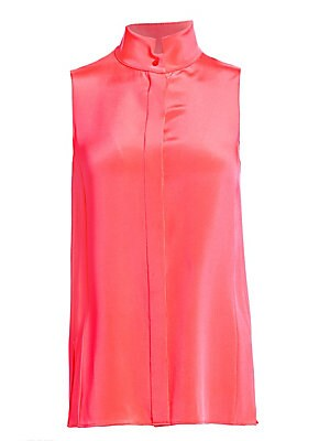 Image of A buttery silk crepe construction adds a lovely weight to this sleeveless blouse. Its minimalist silhouette is enhanced by an architectural collar. Mockneck Sleeveless Concealed button front Side slits Silk Dry clean Imported SIZE & FIT Relaxed silhouette