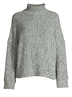 """Image of Lush knit heathered finish cashmere sweater in a cozy loose fit with wide-cut long sleeves. Mockneck Drop shoulders Long wide sleeves Pullover style Rib-knit trim Cashmere Dry clean Imported SIZE & FIT Loose silhouette About 24.25"""" from shoulder to hem Mo"""