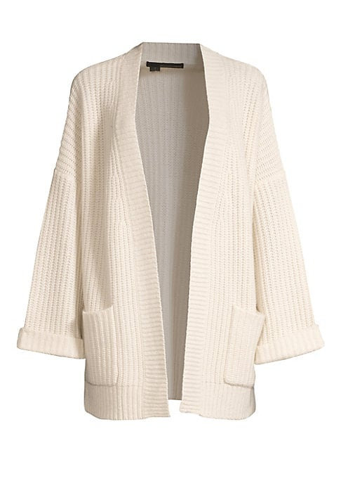 """Image of Generously sized open front cardigan envelops you in the warmth and coziness of pure cashmere. Collarless. Drop shoulders. Long sleeves. Folded cuffs. Open front. Patch pockets. Cashmere. Dry clean. Imported. SIZE & FIT. Loose silhouette. About 32"""" from s"""