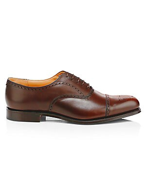 Image of British-made semi brogues crafted from fine leather. Leather upper Cap toe Lace-up vamp Leather lining and sole Made in UK. Men's Shoes - Mens Classic Footwear > Saks Fifth Avenue. Church's. Color: Brandy. Size: 7 UK (8 US).