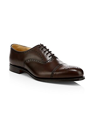 Image of British-made semi brogues crafted from fine leather. Leather upper Cap toe Lace-up vamp Leather lining and sole Made in UK. Men's Shoes - Mens Classic Footwear > Saks Fifth Avenue. Church's. Color: Ebony. Size: 10 UK (11 US).