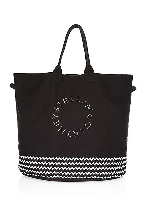 Image of Chambray tote bag with signature logo and chevron graphics. Double top handles. Double side handles. Open top. Fully lined. Cotton. Spot clean. Imported.