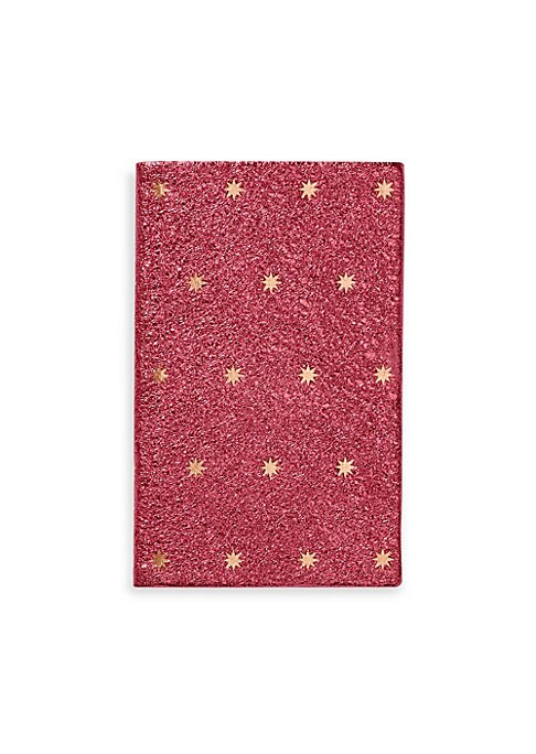 "Image of From the Festive Capsule Collection. Metallic blush pocket notebook bound in calf leather with star motif. Leather/gilt-edged pale blue featherweight paper. Made in UK. SPECIFICATIONS.128 pages.3.5""W x 5.5""H."