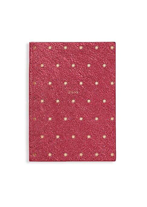"Image of From the Festive Capsule Collection. Metallic blush diary bound in calf leather with star motif. Week-to-view layout with notes page. End notes. One interior slip pocket. Leather/gilt-edged pale blue Featherweight paper. Made in UK. SPECIFICATIONS.5.5""W x"