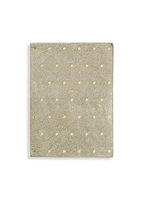 "Image of From the Festive Capsule Collection. Metallic platinum diary bound in calf leather with star motif. Week-to-view layout with notes page. Includes one interior slip pocket. Leather/gilt-edged pale blue featherweight paper. Made in UK. SPECIFICATIONS.5.5""W"