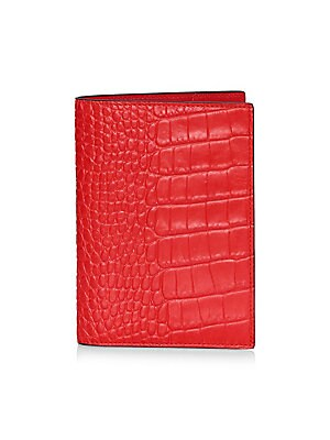 """Image of Elegant passport cover crafted from croco-embossed calf leather. Smooth leather interior. Two slip pockets for passport and boarding pass Contrasting edge paint Made in Italy SIZE 4"""" W x 5.5"""" H. Gifts - Books And Music. Smythson. Color: Red."""