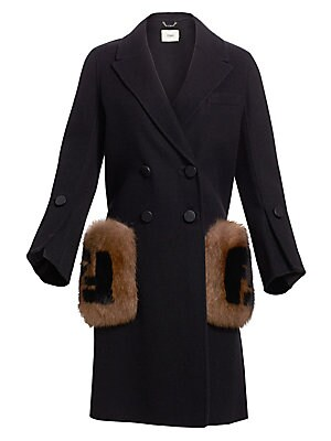 Image of This refined double-breasted coat with buttoned cuffs flaunts the signature Fendi logo on fox fur patch pockets. This is a true statement piece. Notch lapels Long sleeves Buttoned cuffs Double-breasted button front Waist fox fur patch pockets Woven finish
