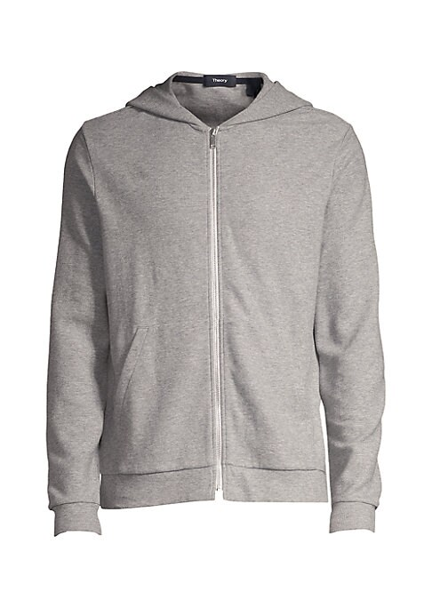 """Image of A full zip sweatshirt with a waffle texture in a cotton-blend fabrication. Attached drawstring hood. Long sleeves. Zip front. Rib-knit trim. Waist pockets. Cotton/elastane. Dry clean. Imported. SIZE & FIT. Regular fit. About 28"""" from shoulder to hem."""