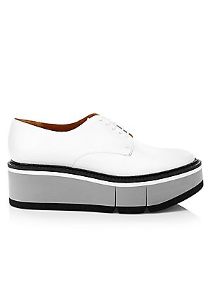 """Image of A bold flatform sole adds an edgy twist the classic oxfords. Leather upper Leather lining Padded insole Lace-up closure Elastomere sole Made in France SIZE Flatform, about 1.38"""" Heel, about 2.17"""". Women's Shoes - Designer Classics. Clergerie. Color: White"""