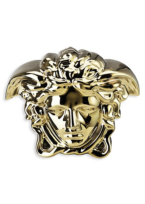 """Image of This iconic 3D Medusa bank is a new addition to the incredible gift collection by Rosenthal meets Versace. Porcelain. Wipe clean. Made in Germany. SIZING.8""""W x 6.5""""H x 4""""D."""