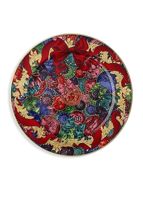 """Image of From the Reflections of Holidays Christmas Collection. This porcelain plate is printed with bows and features Baroque elements that are unmistakably Versace. Porcelain. Hand wash. Made in Germany. SIZING. Diameter, 11.75""""."""