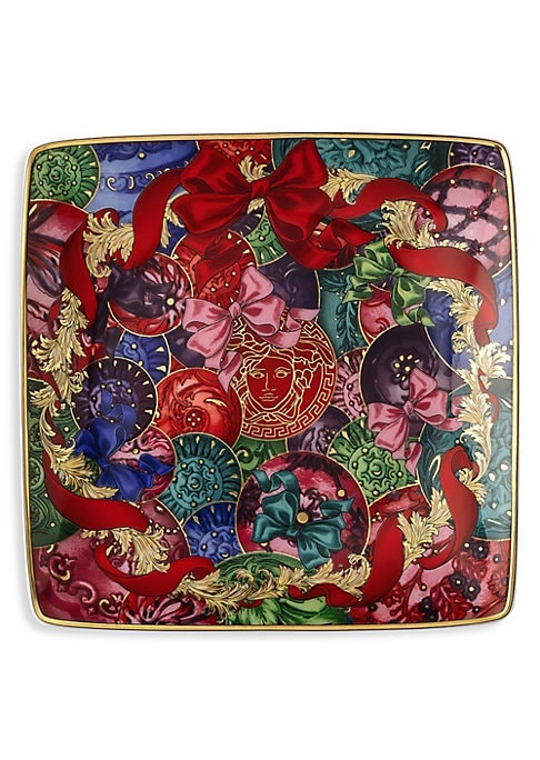 """Image of From the Refections of Holidays Christmas Collection. This square canape plate is printed with bows and features Baroque elements that are unmistakably Versace. Porcelain. Hand wash. Made in Germany. SIZING.4.75""""W x 4.75""""H."""