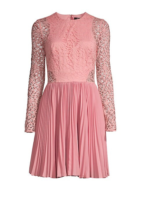 "Image of Romantic lace bodice accentuates whimsically pleated skirt for a lovely look. Roundneck. Long sleeves. Concealed back zip. Accordion pleated skirt. Nylon/spandex/polyester. Dry clean. Imported. SIZE & FIT.A-line silhouette. About 34.5"" from shoulder to he"