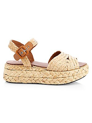 """Image of Allover raffia accents define these beach-ready wedges with adjustable ankle strap. Raffia upper Open toe Buckled ankle strap Leather lining Elastomere sole Imported SIZE Wedge heel, 2"""" (50mm). Women's Shoes - Designer Classics > Saks Fifth Avenue. Clerge"""