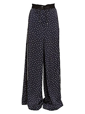 Image of Putting her own spin on both the track and the pajama pant trend, designer Chitose Abe has splattered her silky version with polka dots. An ultra-roomy leg recalls the 90s raver silhouette while simultaneously feeling very current. Ruched drawstring waist