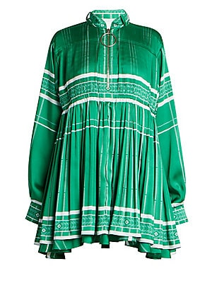 """Image of A shift mini dress with smocked details and an eye-catching voluminous skirt. Stand collar Long sleeves Quarter zip placket Button barrel cuffs Smocked detail Empire waist Polyester Dry clean Made in Italy SIZE & FIT Shift silhouette About 34"""" from should"""