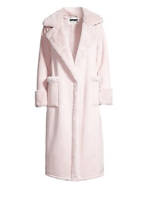 "Image of Revel in the soft warmth of this chic faux fur coat. Spread collar Long cuffed sleeves Hidden one button snap closure Front patch pockets Lined Polyester Fur type: Faux Dry clean Imported SIZE & FIT About 45"" shoulder to hem Model shown is 5'10"" (177 cm)"