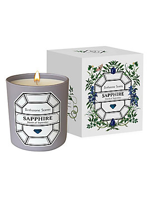 "Image of Inspired by sapphire, the birthstone of September, this candle is scented by a blend of Calabrian bergamot, freesia, and star anise. Paraben free and cruelty free. Soy blend wax Made in USA SPECIFICATIONS Burn time: 50 hours 8.5 oz. 3""W x 3.5""H x 3""D. Fra"