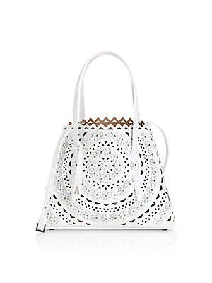 """Image of A delicate scalloped laser-cut design defines this rich leather tote. Open top One interior zip pouch Leather Made in Italy SIZE Double top handles, 5.5"""" drop 10""""W X 8""""H X 4.75""""D. Handbags - European Collection Hdba > Saks Fifth Avenue. Alaïa. Color: Blan"""