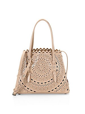 """Image of A delicate scalloped laser-cut design defines this rich leather tote. Open top One interior zip pouch Leather Made in Italy SIZE Double top handles, 5.5"""" drop 10""""W X 8""""H X 4.75""""D. Handbags - European Collection Hdba > Saks Fifth Avenue. Alaïa. Color: Sabl"""
