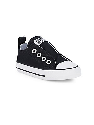 Image of Canvas slip-on sneakers without the laces. Canvas upper Slip-on style Rubber sole Wipe clean Imported. Children's Wear - Children's Shoes > Saks Fifth Avenue. Converse. Color: Black. Size: 10 (Toddler).
