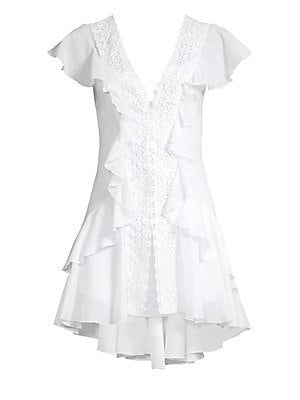 Image of Breezy layers of ruffles with lace trim and high-lo whem creates a charming, flirty dress. V-neck Short ruffled sleeves Front snap-button closure Scoop back High-low hem Cotton/polyester Hand wash Made in Spain SIZE & FIT Fit-and-flare silhouette About 34