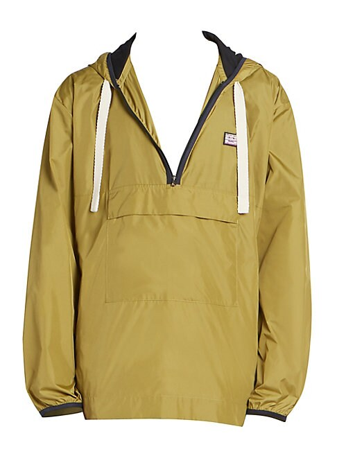 Image of Channel the outdoors in nylon pullover accented with contrasting trims, Acne Studios emoticon face patch, storage pockets and zippered side seams for a breathable fit. Attached drawstring hood. Long sleeves. Elasticized cuffs. Partial front zip. Pullover