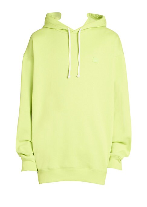 """Image of Bold neon hoodie is a statement essential. Attached drawstring hood. Long sleeves. Rib-knit cuffs and hem. Pullover style. Cotton. Machine wash. Imported. SIZE & FIT. About 33"""" from shoulder to hem."""