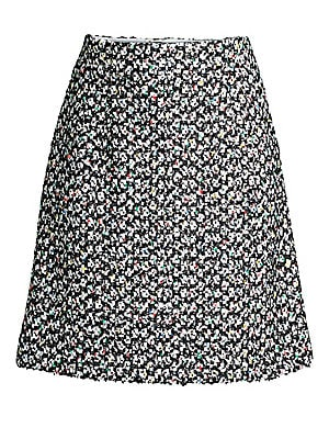 Image of At first glance, this tweed skirt appears to be composed of black and white, but upon closer inspection a lively array of very Escada colors emerge. Both playful and sober all at once, this skirt is easy to match with all sorts of garments and tweak to th