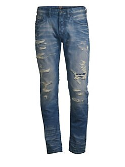 cc4ca7bcd6bb Ripped   Repaired Slim-Fit Jeans INDIGO. QUICK VIEW. Product image