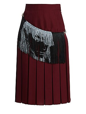 Image of A fringed panel slopes about this pleated skirt, emblazoned with a ghostly black-and-white face for a punky touch. Its midi-length - and the fact that the fringe is removable - make this an easy-to-wear piece. Banded waist Concealed side zip and hook clos
