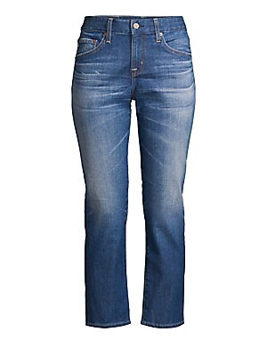 """Image of Casual cool slim leg jeans flaunt faded whiskered details. Belt loops Zip fly with button closure Five-pocket style Back logo patch Cotton/polyurethane Dry clean Imported SIZE & FIT Cropped length Rise, about 9"""" Inseam, about 26"""" Leg opening, about 10"""" Mo"""