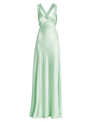 Image of A diaphanous silk construction highlights the fluttering fluid line of this exquisite gown. With a plunging, cut-down-to-there neckline and an open cutout back accented with crisscross straps, this garment exudes a seductive sense of luxury. V-neck Should