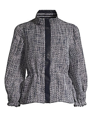 Image of Textured peplum jacket finished with contrast placket and puffed three-quarter sleeve jacket. Stand collar Three-quarter length puff sleeves Front covered zip close Peplum waist Elasticized cuffs Polyester/rayon Dry clean Imported SIZE & FIT Peplum silhou