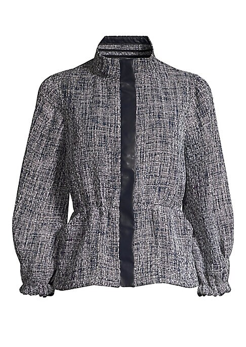 Image of Textured peplum jacket finished with contrast placket and puffed three-quarter sleeve jacket. Stand collar. Three-quarter length puff sleeves. Front covered zip close. Peplum waist. Elasticized cuffs. Polyester/rayon. Dry clean. Imported. SIZE & FIT. Pepl