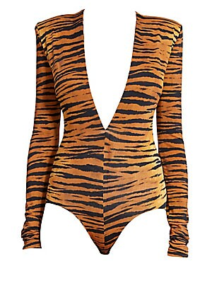"""Image of A statement plunge bodysuit flaunting bold animal-print with structured shoulders. Plunging V-neck Long sleeves Bottom snap closure High-cut leg Viscose/elastane Made in Italy SIZE & FIT Fitted silhouette About 28"""" from shoulder to hem Model shown is 5'10"""